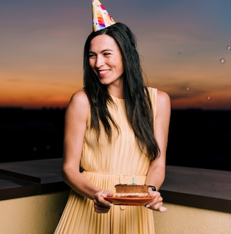 Birthday woman celebrating on rooftop