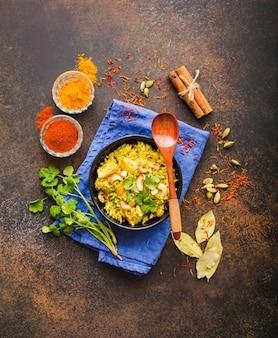 Biryani rice, traditional indian dish. biryani spicy rice, chicken, nuts.