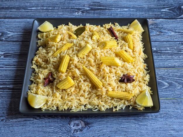 Biryani with baby corn. spicy baby corn rice. indian food