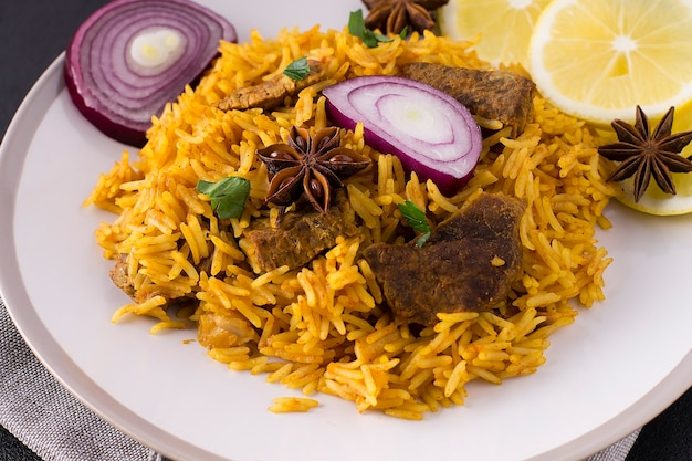 Biryani with chicken. traditional indian dish of rice and chicken, with spices and lemon.