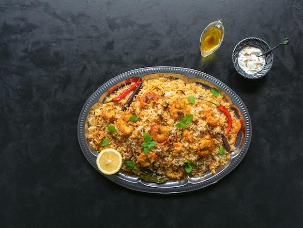 Biryani with shrimp. tasty and delicious prawns biryani, top view.