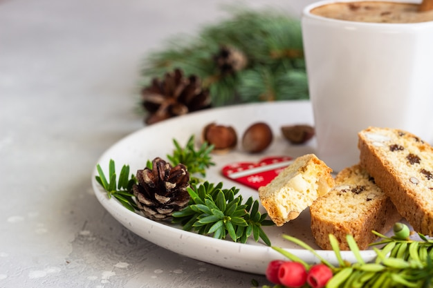 Biscotti with hazelnuts and a cup of coffee