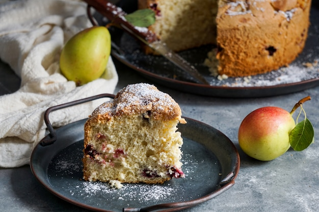 Biscuit cake with berries and pears