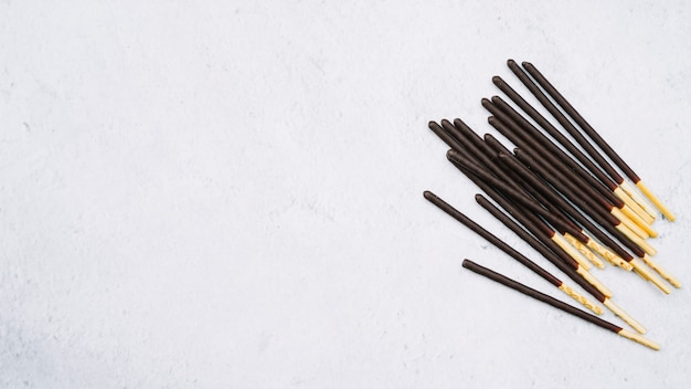 Biscuit sticks in chocolate on white backdrop