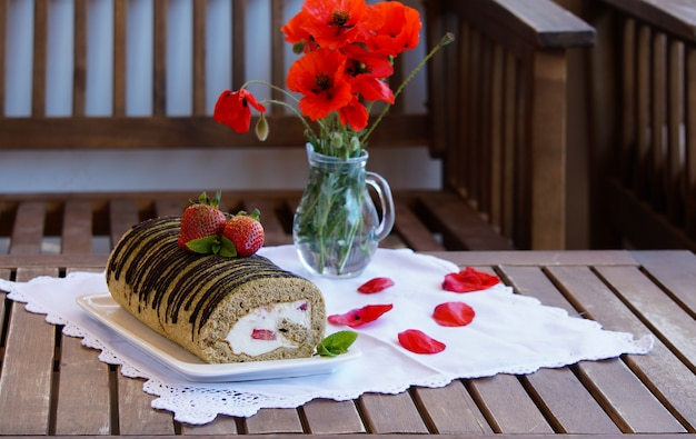 Biscuit tea matcha rolled cake with mascarpone cream with strawberries and green tea matcha