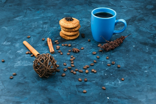 Biscuits and coffee cup on a dark blue background