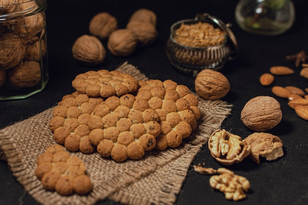 Biscuits and nuts on black surface