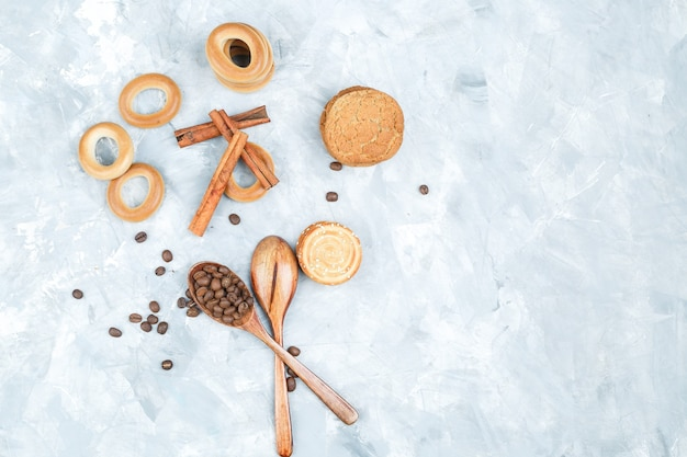 Biscuits with coffee beans on grungy background