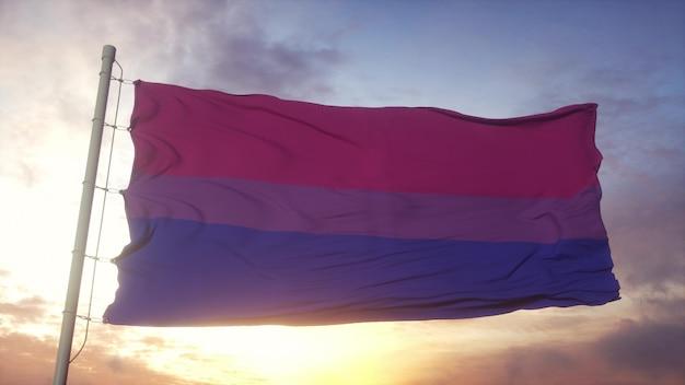 風、空、太陽の背景に手を振るバイセクシャルプライドフラグ。 3dレンダリング。