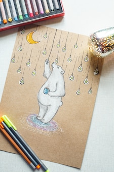 Бишкек, кыргызстан - 28 марта 2018 года: концепция живописи. иллюстрация белого медведя на белой таблице, и карандаши.