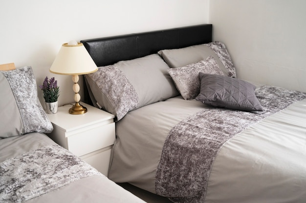Bishop, auckland, u.k. 27 july, 2021. luxurious double bed in hotel room. gray bedroom with towels on the bed, ready to chek in. indoor home design