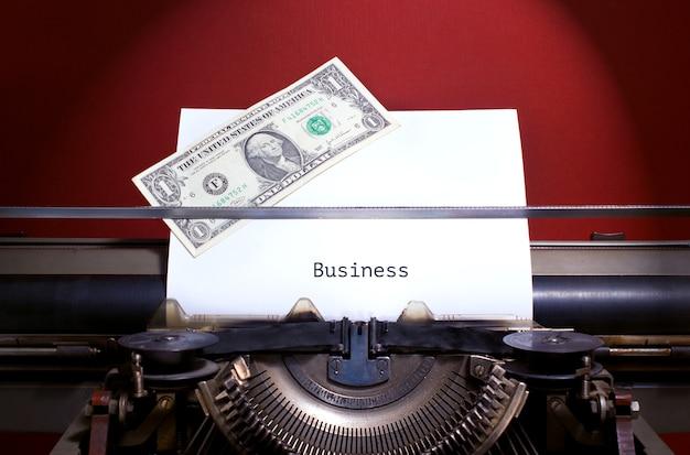 Bisness guidelines, title heading typewritten on paper on vintage manual typewriter machine.