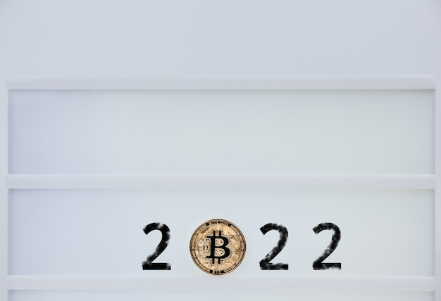 Bitcoin 2022. bitcoins are next to the numbers 2. prediction of price bitcoin in year 2022. future bitcoin value for 2020, 2022, 2030.