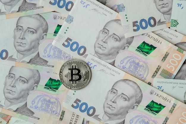 Bitcoin against the background of the ukrainian hryvnia.