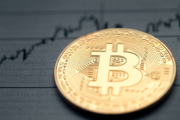 Bitcoin on the background of a rising chart