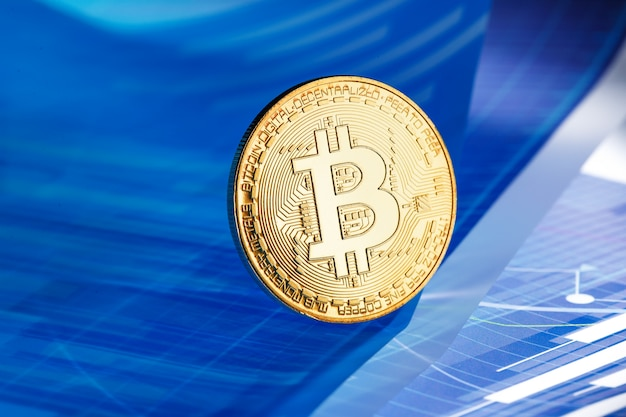Bitcoin on blue abstract finance background. bitcoin cryptocurrency
