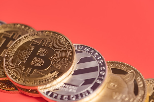 Bitcoin btc and dogecoin doge group included with cryptocurrency coin red background