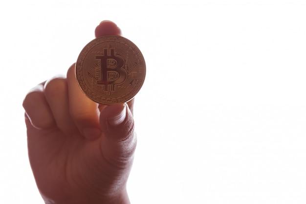 Bitcoin btc in a female hand