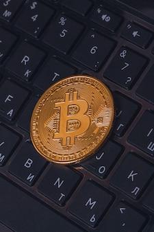 Bitcoin btc gold coin close up on a computer keyboard