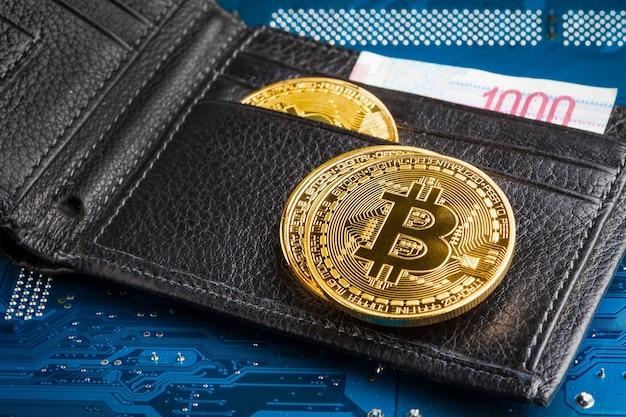 Bitcoin coin. bitcoin-crypto-currency on a computer. coin in focus.