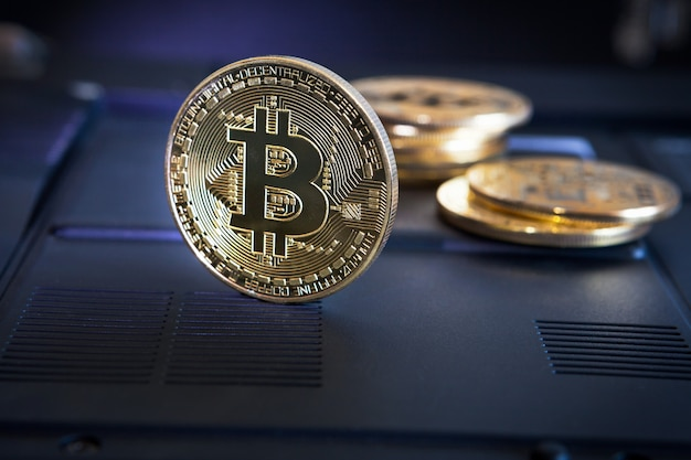 Bitcoin coin on black  surface. bitcoin cryptocurrency on a computer  surface.