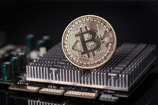 Bitcoin coin on cooler motherboard. crypto currency. close up