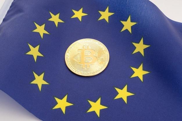 Монета биткойн на флаге европейского союза. криптовалюта в европе
