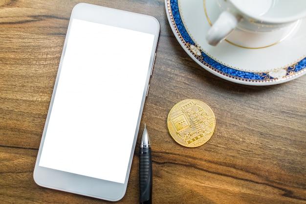 Bitcoin coin on smartphone