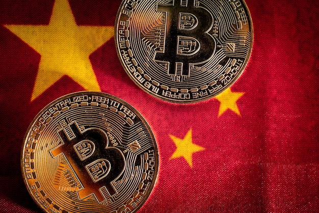 Bitcoin coins on the flag of china, country against its use, recently banned.