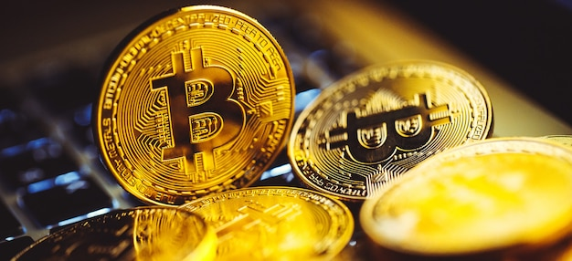 Bitcoin coins on laptop keyboard. cryptocurrency.