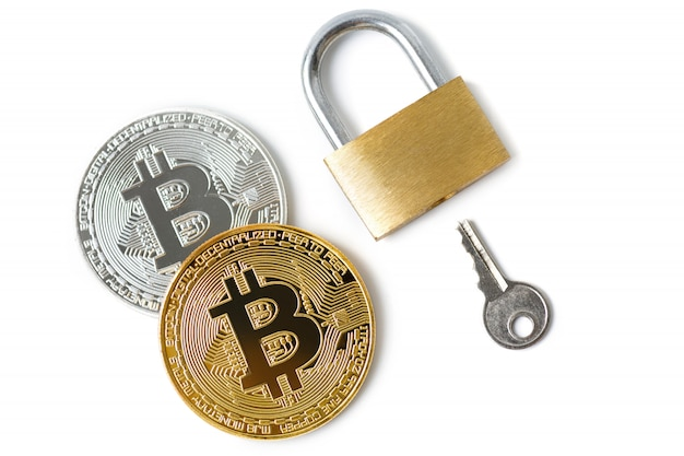 Bitcoin coins and padlock on white