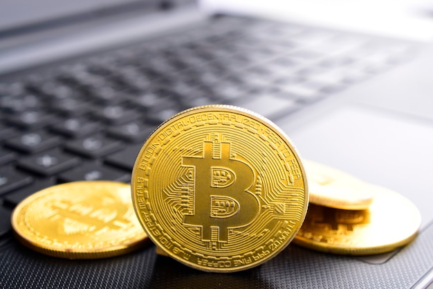 Bitcoin concept  virtual currency coins on laptop blockchain