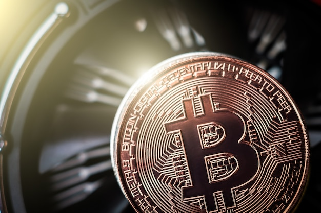 Bitcoin on cooling computer fan background