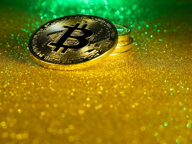 Bitcoin crypto currency gold bitcoin btc macro shot of bitcoin coins blockchain technology bitcoin m...