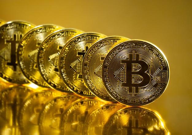 Bitcoin. crypto currency gold bitcoin, btc. macro shot of bitcoin coins. blockchain technology, bitcoin mining concept.