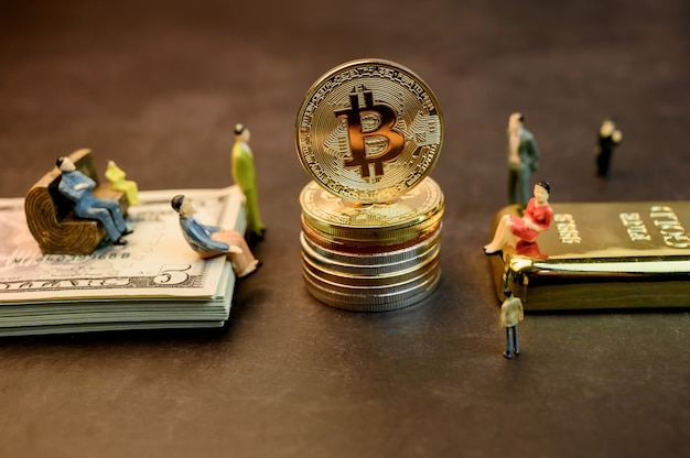 Bitcoin of crypto currency with gold, money and miniature toy. new virtual of technology and business for blockchain