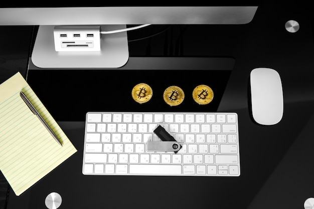 Bitcoin cryptocurrency coin on keyboard