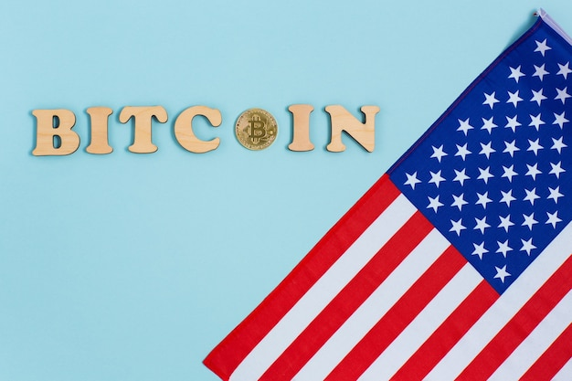 Bitcoin cryptocurrency coins next to american flag