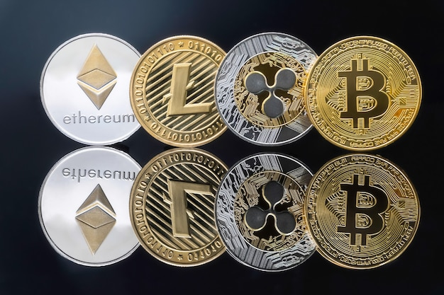 Bitcoin and cryptocurrency investing concept - physical metal bitcoin coins with black shinny.