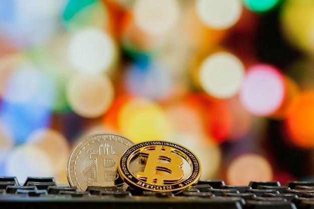 Bitcoin currency on keyboard computer on bokeh