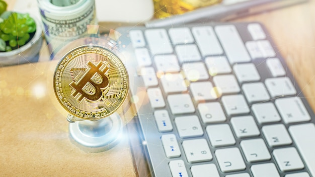The bitcoin currency on office table for business content.