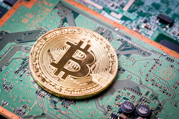 Bitcoin, the digital currency   on motherboard background