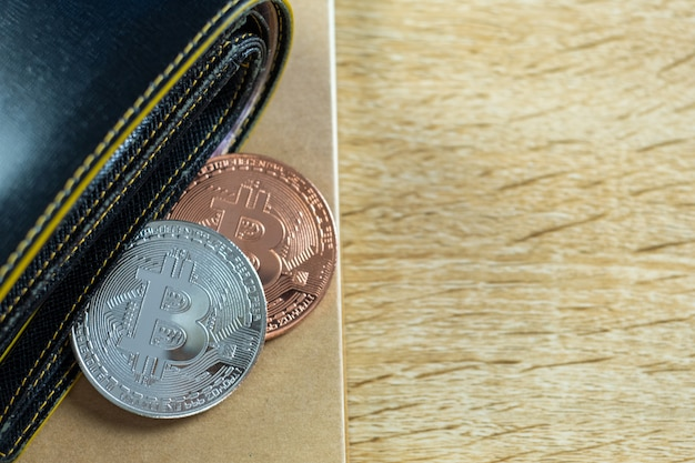Bitcoin digital currency with leather wallet or purse