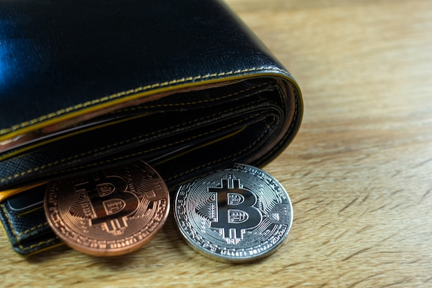 Bitcoin digital currency with leather wallet