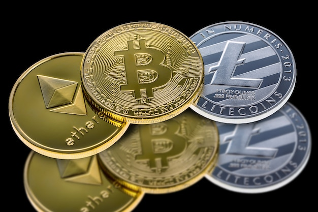 Bitcoin, ethereum and litecoin coins isolated on black with reflection.