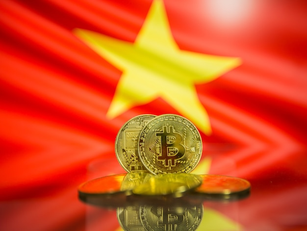 Bitcoin gold coin and defocused flag of vietnam background. virtual cryptocurrency concept.
