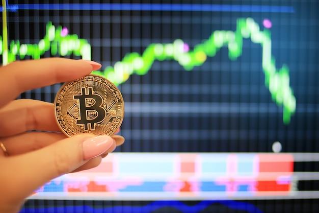 Bitcoin golden coin over digital graph