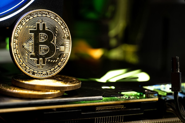 Bitcoin golden coins on a gpu with neon light. the future of money.