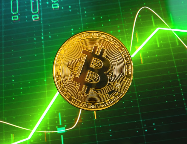 Bitcoin and green stock chart growth graphs on the background, crypto currency exchange and trading concept photo