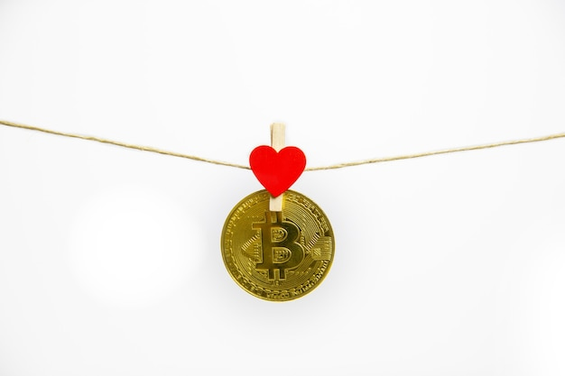Bitcoin hanging with red heart isolated on white background.
